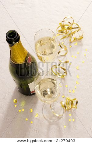 Champagne Bottle And Two Glasses On Party Table