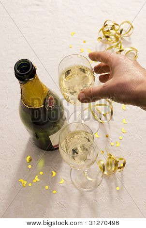 Hand Reaches For Champagne Glass At Party