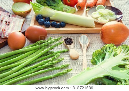 Healthy Nutrition Vegetable Food and Kitchen Cuisine Concept, Raw Ingredients Vegetarian Natural Food for Healthy Eating. Fresh Meal Preparation for Cooking, Mix Fruits and Vegetables on The Table.
