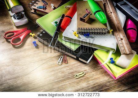 Colorful School Supplies Over Wooden Desktop. Back To School Concept