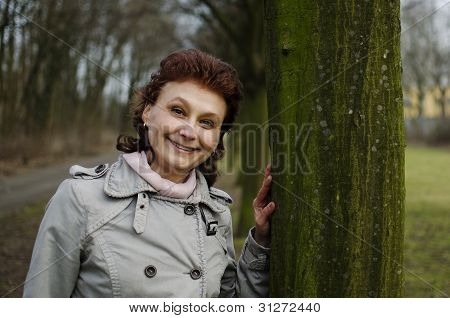 Happy Woman Smiling In A Park