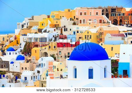 Santorini Island, Greece, Oia Village Panoramic View With Blue Church Dome And Colorful Houses