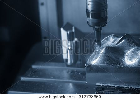 The Cnc Milling Machine Cutting The Mold Parts With Index-able Ball Endmill Tools. The Mold And Die