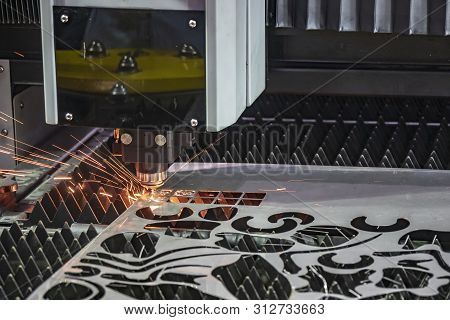 The Laser Cutting Machine Cutting The Metal Plate. The Sheet Metal Process With Fiber Laser Cutting
