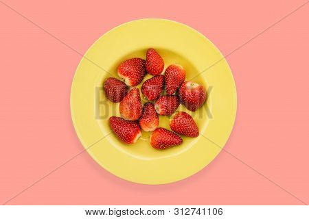 Yellow Plate With Strawberries On A Bright Background. Ripe Strawberries, Red Color In A Yellow Plat