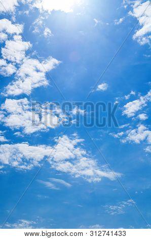 Blue dramatic sky background - colorful sky clouds lit by evening sunset light. Vast sky landscape scene, colorful sky scene. Blue sky background