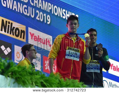 Gwangju, South Korea - Jul 21, 2019. Chinese Sun Yang, Centre, With His Gold Medal As Silver Medalli