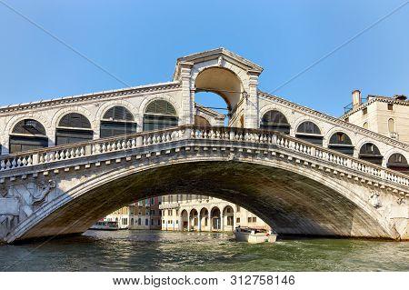 Rialto Bridge ( Ponte Rialto ) On Canal Grande In Venice, Veneto, Italy