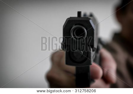 Gunman Aiming His Target.terrorism Shoots A Pistrol Handgun.criminal Murder And Violent Concept - Fi
