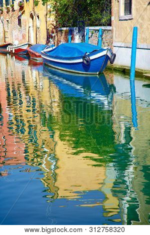 Canals Of Venice With Reflection In Water