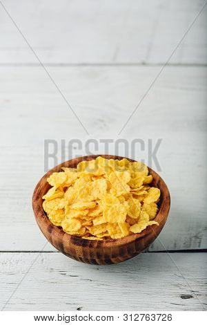 Corn Flakes In A Wooden Rustic Bowl