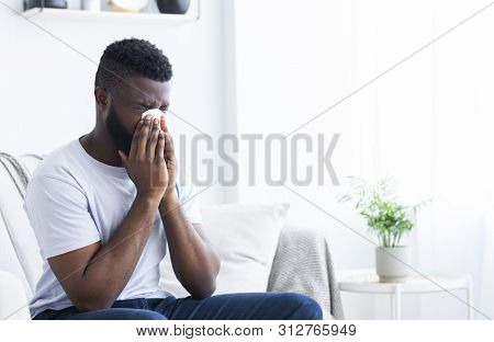 Young Sick African-american Man Cleaning Snotty Nose, Infected By Winter Grippe Virus Or Influenza,