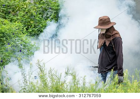 Man Fogging Chemical To Eliminate Mosquito At The Street