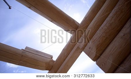 Close-up View Of Wooden Structure Of House. Clip. Building House Of Good Wooden Logs. Construction O