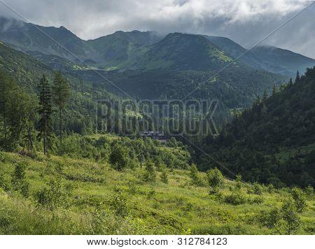 Beautiful Mountain Valley With Mountain Hut Ziarska Chata, Wooden Cottage, Spruce Trees, Dwarf Scrub
