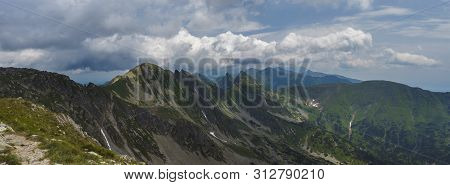 Panoramic View From Banikov Peak On Western Tatra Mountains Or Rohace Panorama. Sharp Green Mountain