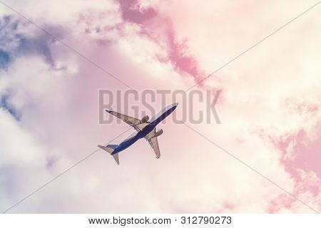 Large Passenger Plane In The Cloudy Sky. Bright Positive Toning. The Concept Of A Summer Holiday In