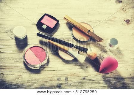 Makeup Set With Various Cosmetic Products And Brushes. Beauty Background With Copy Space