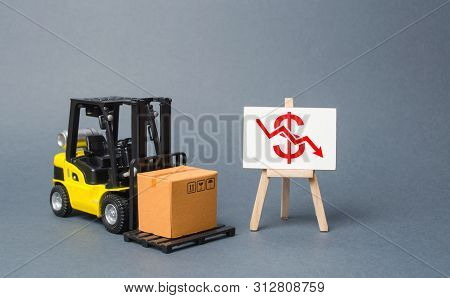 Forklift Truck Carries A Cardboard Box Near A Stand With A Red Dollar Arrow Down. Decline In The Pro