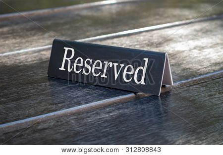 Reserved Sign, Reservation Concept. Text Reserved On Metal Black Color Plate, White Color Letters, O