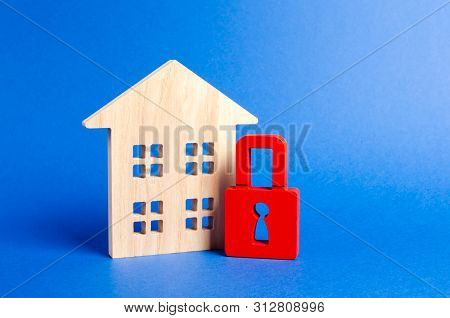 Wooden House And A Red Padlock. Security And Safety. Confiscation For Debts. Alarm System. Seizure O