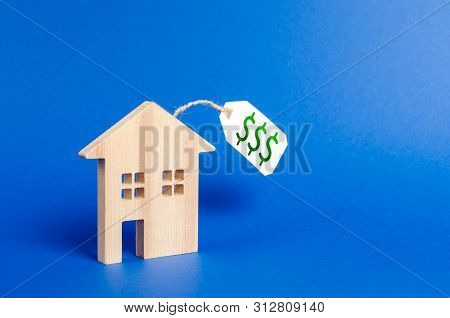 Wooden House Figure And Price Tag. Selling A House Or Auction. Realtor Services. Buying Liquid And E