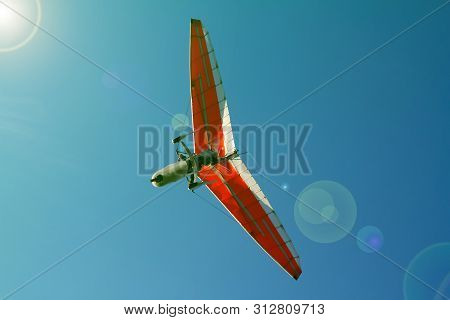 Bottom View Super Lightweight Hang Glider Or Trike Flies In Clear Blue Sky