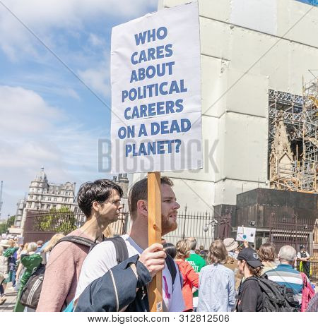 London / Uk - June 26th 2019 - A Man Holds A Climate Change Sign Outside Parliament As Part Of A Tim