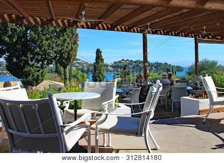Corfu, Greece - October 5th 2012: Covered Bar Area Of Holiday Hotel With Wonderful View Over The Nea