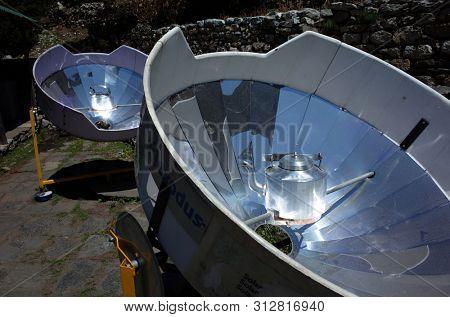 Sagarmatha national park, Nepal - May 17, 2019: Parabolic solar heaters for hot water in Pangboche village, Everest trek, Sagarmatha national park, Solukhumbu, Nepal
