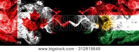Canada Vs Kurdistan, Kurdish Smoky Mystic Flags Placed Side By Side. Thick Colored Silky Smoke Flags