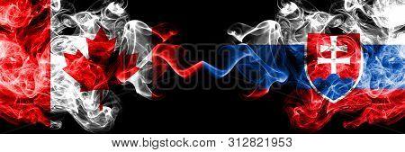Canada Vs Slovakia, Slovakian Smoky Mystic Flags Placed Side By Side. Thick Colored Silky Smoke Flag