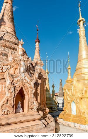 Vertical Picture Of Colorful Indein Temple, Landmark Of Inle Lake, Myanmar