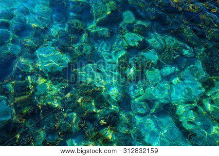 Ibiza Portinatx Arenal Gran beach in Balearic Islands clear water detail