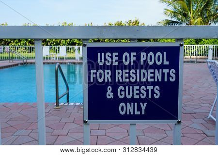 Sign That Tells People The Pool Is For Residents And Guests Only.