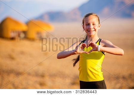 Casual portrait of young girl outdoors on summer day