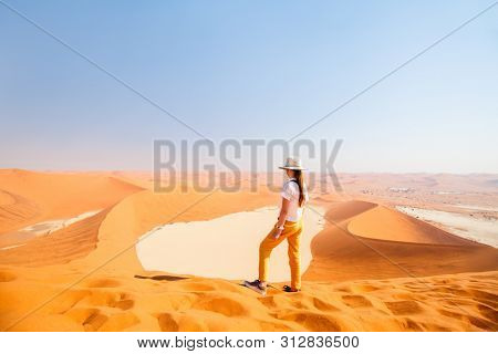 Little girl enjoying breathtaking view from famous red sand dune Big Daddy in Sossusvlei Namibia