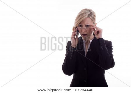 Confused Businesswoman With Phone