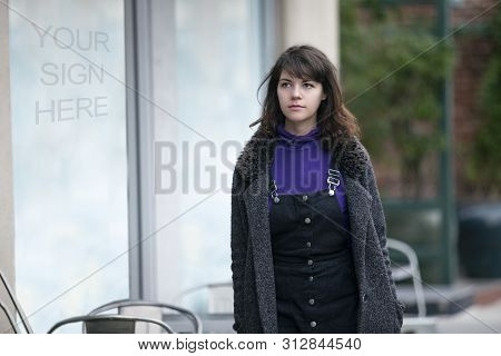 Woman Walking Outdoors In The City Looking At Text Or Logo Space On A Window Display.  Advertising O