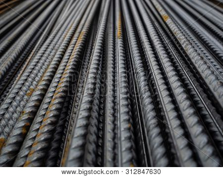 Steel Reinforcement Folded On The Construction Site. Rusty Steel Bars For Concrete Reinforcement. Th