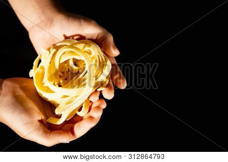 Hands Of A Little Girl Holding E Fresh Home-maded Tagliatelle Pasta