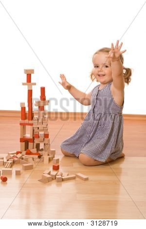 Happy Little Girl With Wooden Blocks