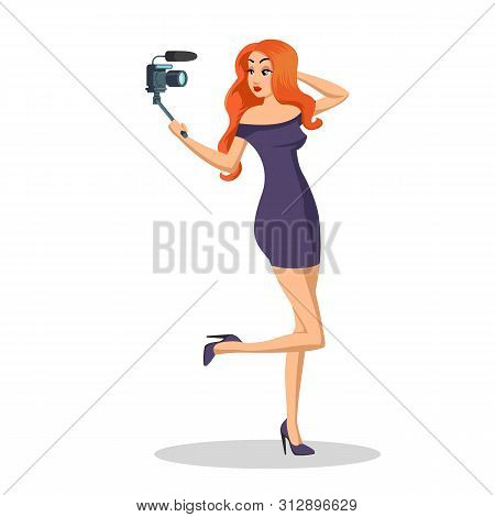 Young Redheaded Woman Looking At Camera With Gimbal. Pretty Young Woman Is Filming New Episode For H