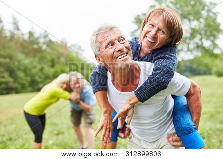 Cheerful seniors have fun together in their free time in nature