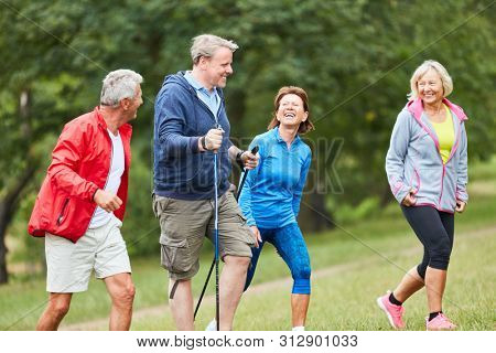 Active seniors in a hiking group traveling together in nature