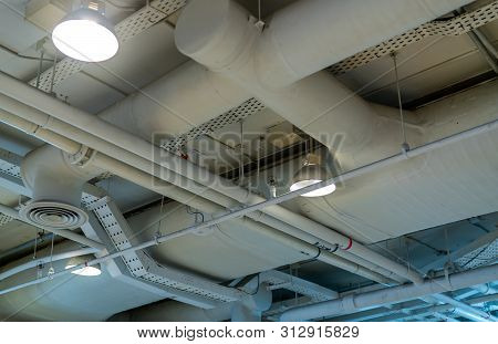 Air Duct, Wiring And Plumbing In The Mall. Air Conditioner Pipe, Wiring Pipe, And Plumbing Pipe Syst