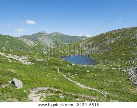 Beautiful Vivid Blue Mountain Lake Horne Jamnicke Pleso With Green Mountain Peaks View From The Jamn