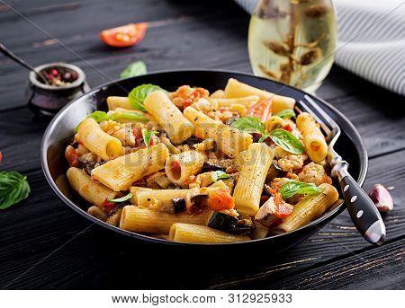 Rigatoni Pasta With Chicken Meat, Eggplant In Tomato Sauce In Bowl. Italian Cuisine.