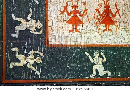 Dancing Figures On An Aged Background.
