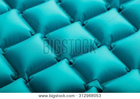 Texture Of A Blue Inflatable Tourist Rug, Repeating Sections And Patterns. Air Mattress Ultralight P